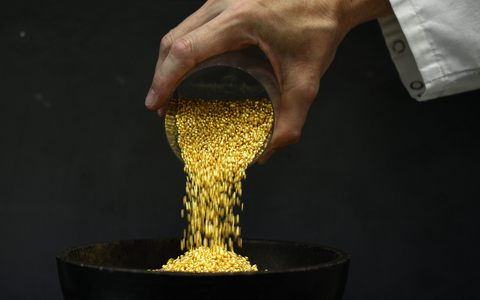 An employee empties a cup of gold granules at the Austrian Gold and Silver Separating Plant 'Oegussa' in Vienna