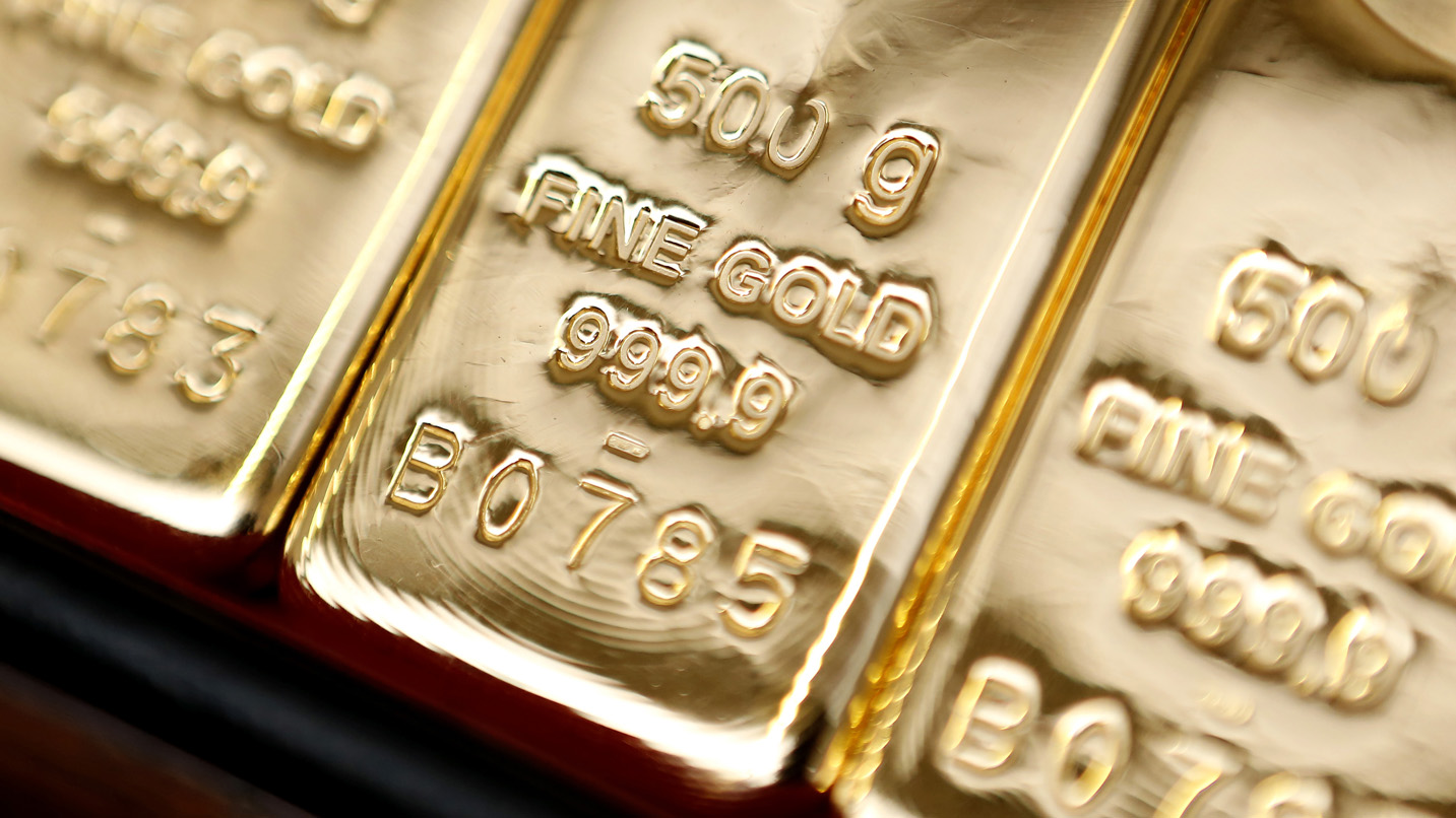 Gold bars weighing fifty grams and bearing the Italpreziosi SpA hallmark are seen on display at the precious metals refinery plant in Arezzo, Italy, on Friday, July 19, 2013. Hedge funds raised bets on a gold rally before prices capped the biggest two-week gain in 20 months as Federal Reserve Chairman Ben S. Bernanke damped speculation that a cut in stimulus is imminent. Photographer: Alessia Pierdomenico/Bloomberg
